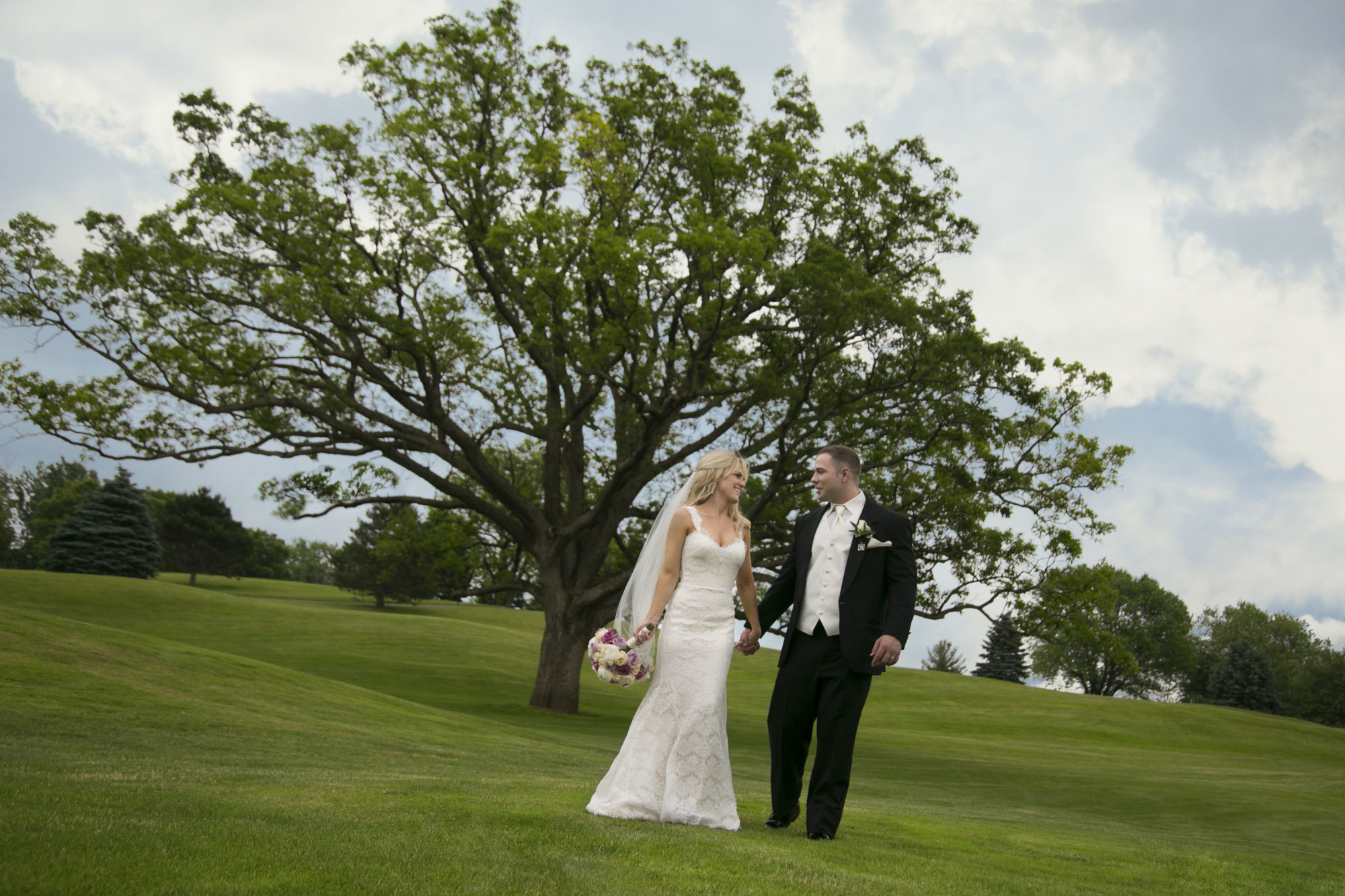 Bride and groom with tree